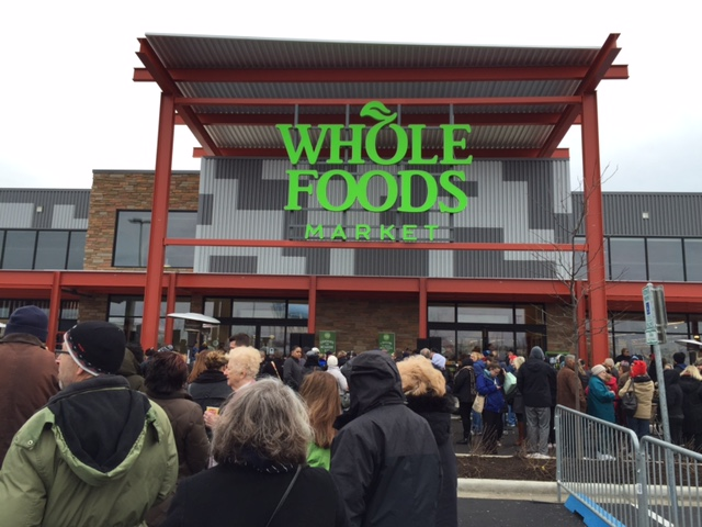 "Shoppers watch the Whole Foods ""bread breaking"" ceremony"